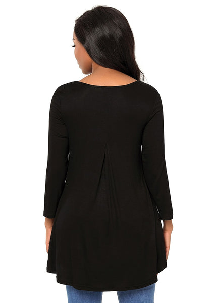 Back view of model in black strappy 3/4 sleeves tulip-hem blouse