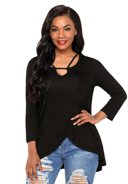 Model poses wearing black strappy 3/4 sleeves tulip-hem blouse