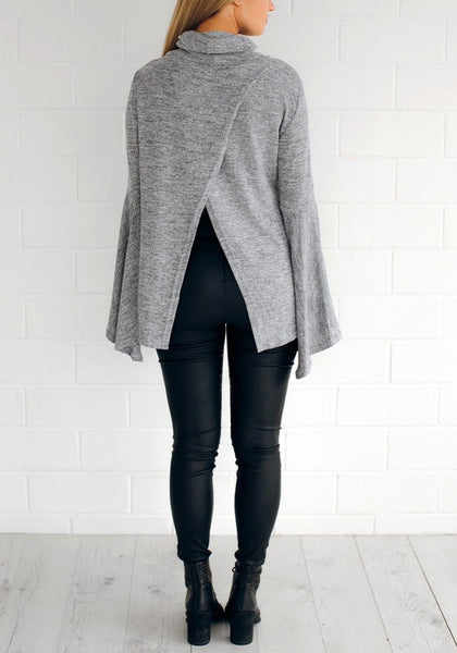 Back full body shot of lady in grey bell-sleeved back-slit top