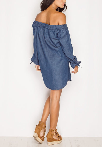 Back full body shot of model wearing off-shoulder chambray tunic