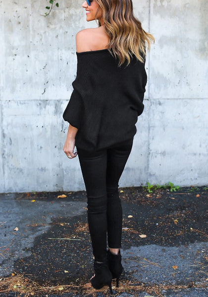 Back full body shot of woman in black off-shoulder bat sleeves sweater