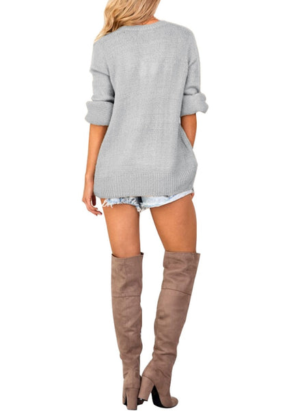 Back full body shot of woman wearing light grey lantern sleeves surplice sweater