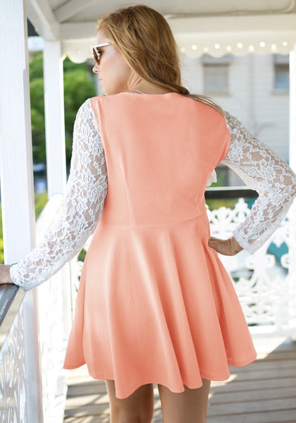 Back of girl in an apricot lace sleeve skater dress