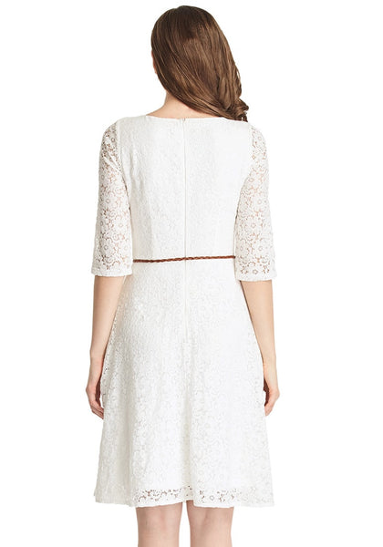 Back shot of brunette woman in white lace crop sleeves A-line dress