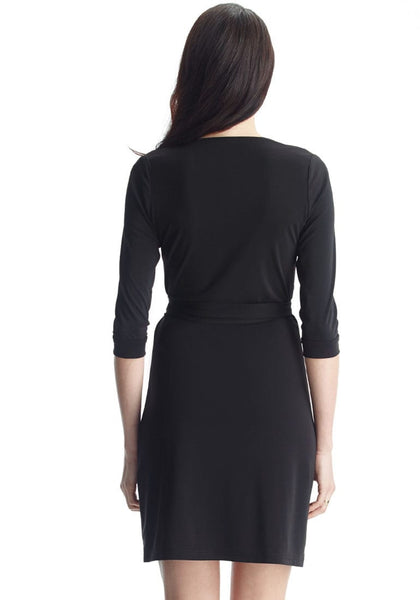 Back shot of lady in black plunge wrap-style belted dress