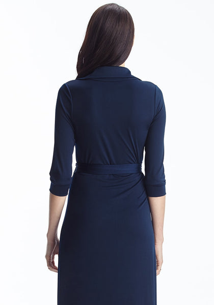 Back shot of lady in navy blue plunge wrap belted maxi dress