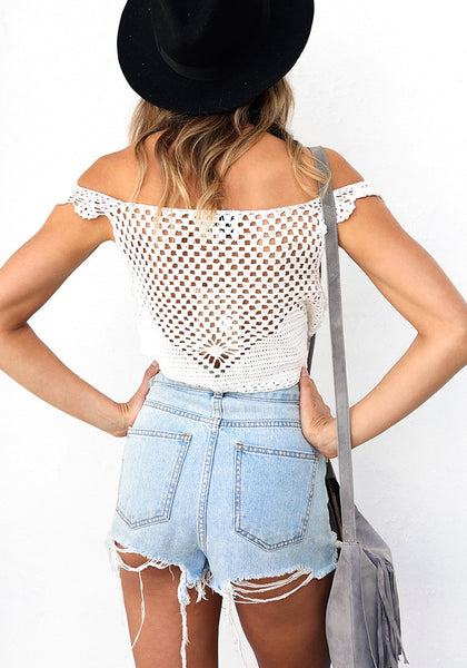 Back shot of lady in white crochet cutout off-shoulder crop top