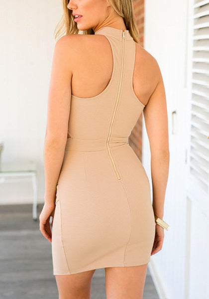 Back shot of model in a f peach keyhole wrap-style dress