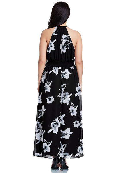 Back shot of model in black floral-printed plunge maxi dress