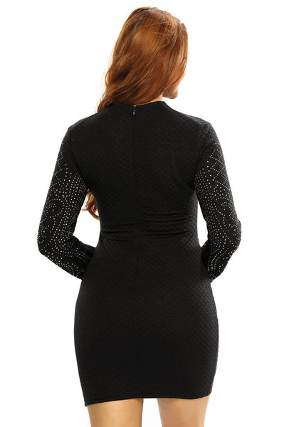 Back shot of model in black jeweled quilted dress