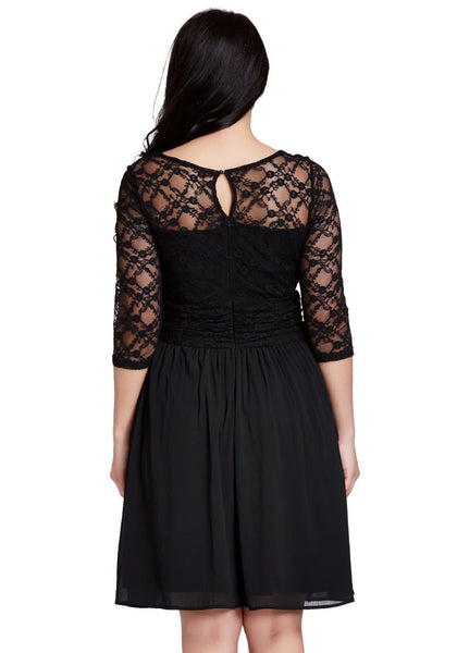 Back shot of model in black lace crop-sleeves skater dress