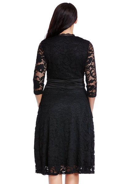 Back shot of model in black lace surplice ruched-waist dress
