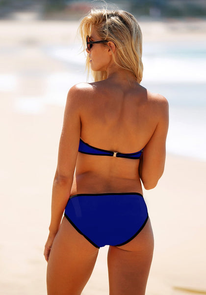 Back shot of model in blue contrast color bikini