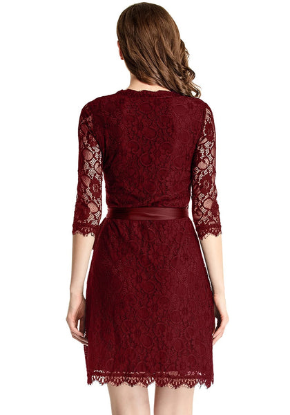 Back shot of model in burgundy lace overlay plunge wrap-style dress