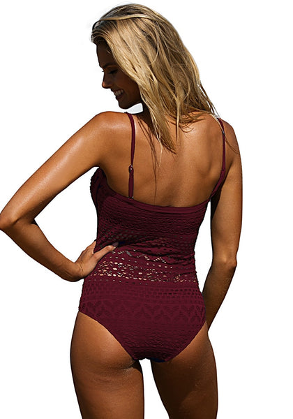 Back shot of model in dark burgundy lace halter swimsuit