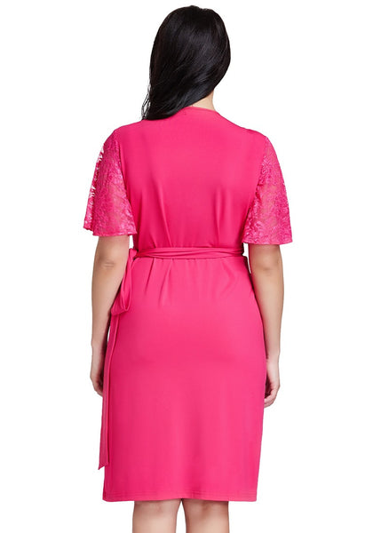 Back shot of model in hot pink plunge wrap-style dress