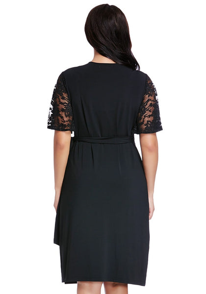 Back shot of model in plus size black plunge wrap-style dress
