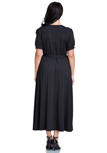 Back shot of model in plus size black surplice belted long dress