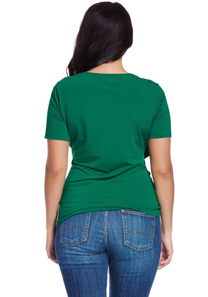 Back shot of model in plus size green ruched surplice top