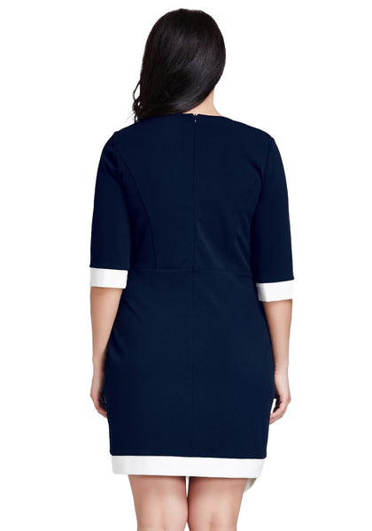 Back shot of model in plus size navy asymmetric wrap bodycon dress