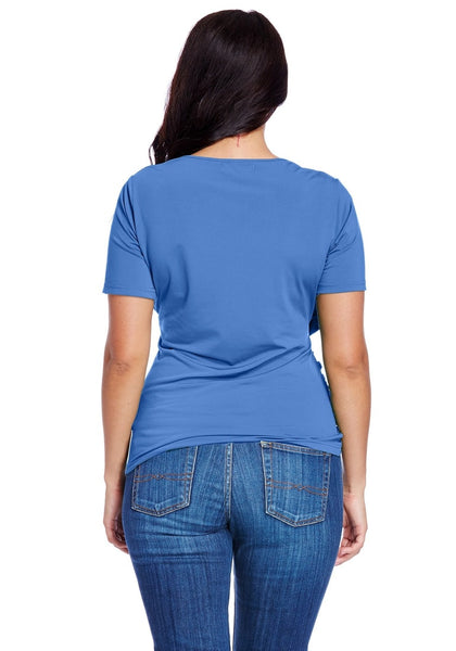 Back shot of model in plus size sky blue ruched surplice top