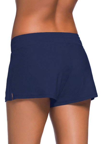 Back shot of model in royal blue drawstring side-slit board shorts
