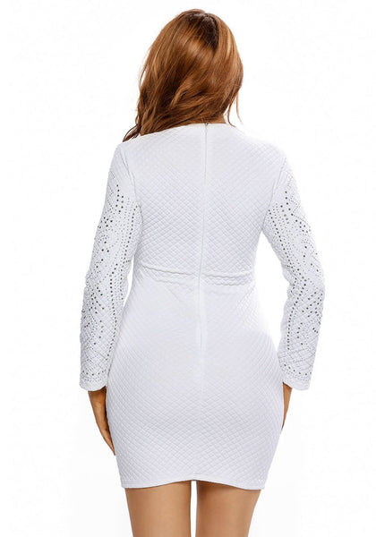 Back shot of model in white jeweled quilted dress