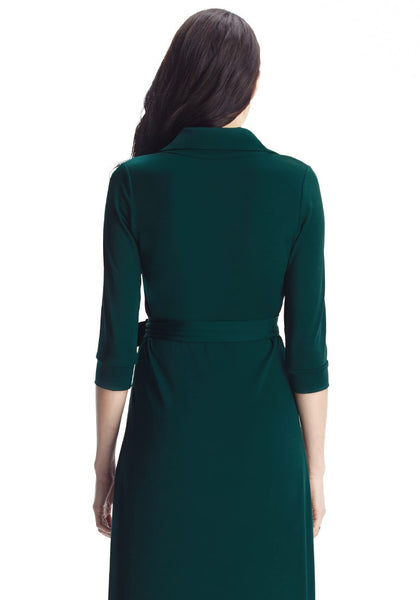 Back shot of model wearing dark green plunge wrap belted maxi dress