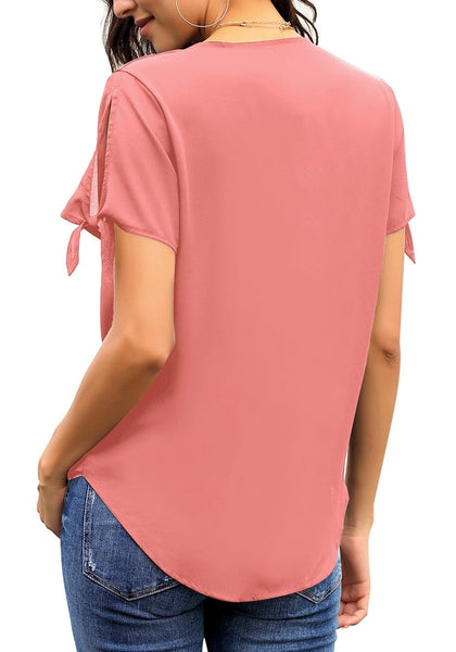 Back shot of model wearing pink V-neck split tie sleeves loose surplice top
