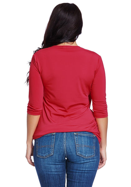 Back shot of model wearing plus size red ruched surpliced top