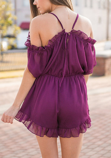 Back shot of model wearing purple cold-shoulder ruffled romper