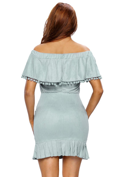 Back shot of pretty model in light blue ruffled off-shoulder pompom dress