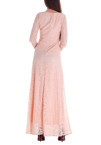 Back shot of woman in a pink maxi lace dress