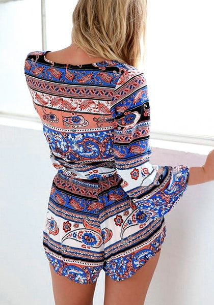 Back shot of woman in ethnic plunge drawstring romper