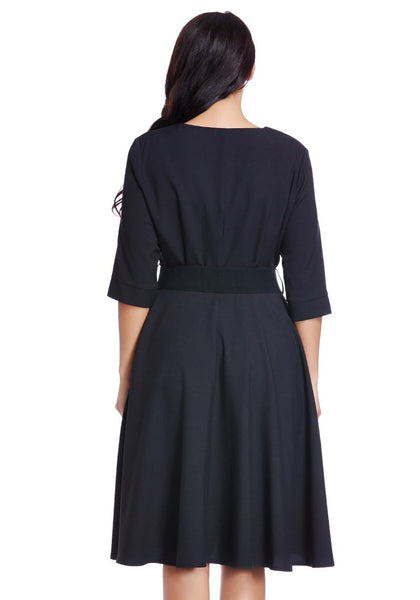 Back shot of woman in plus size black belted skater dress