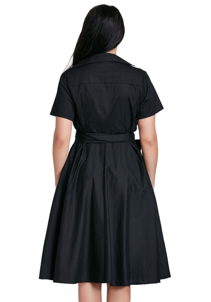 Back shot of woman in plus size black surplice midi dress