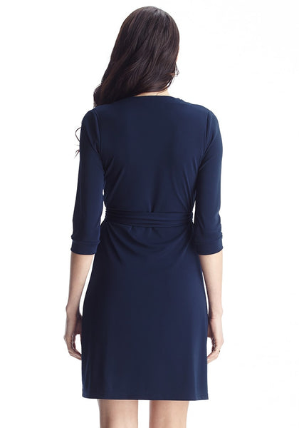 Back shot of woman wearing navy plunge wrap-style belted dress