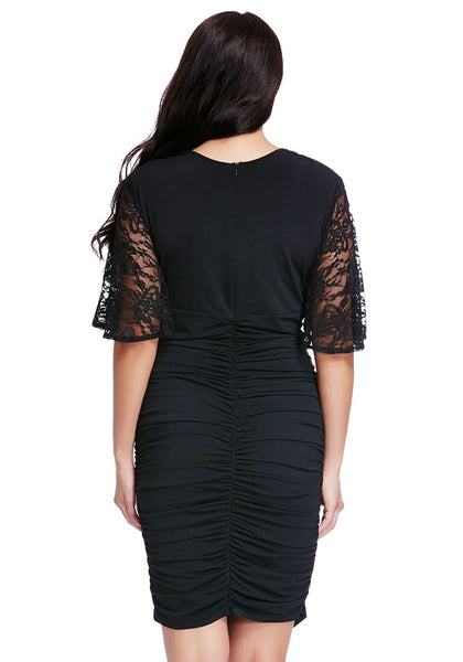 Back shot of woman wearing plus size black ruching bodycon dress