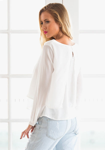 Back side view of girl in white layered chiffon blouse