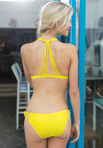 Back side view of model in Caged Yellow Bikini Set