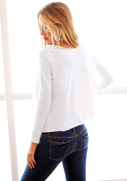Back side view of model in white loose high-low tee