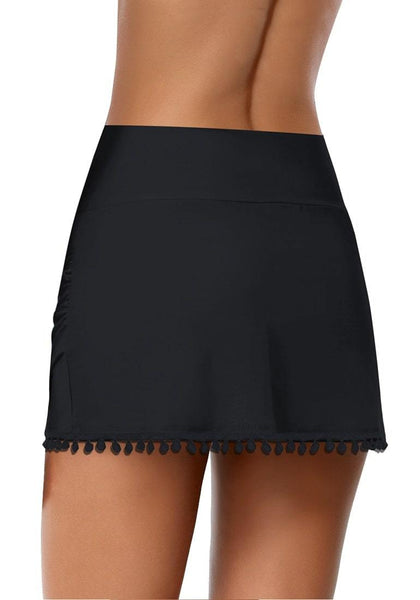 Back view of black tulip hem tassels mid-waist ruched swim skirt