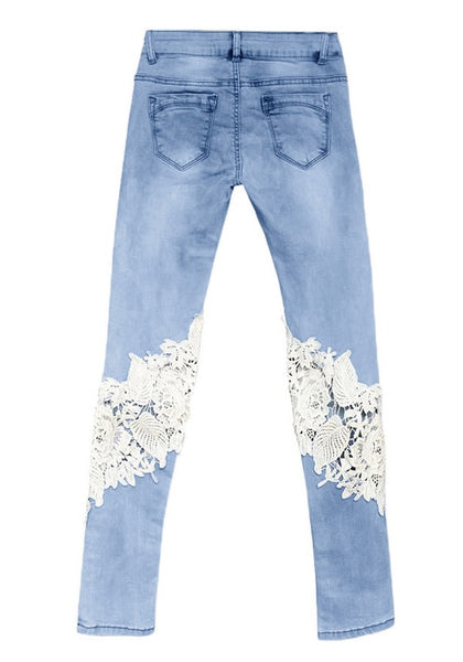 Back view of blue lace-paneled skinny jeans