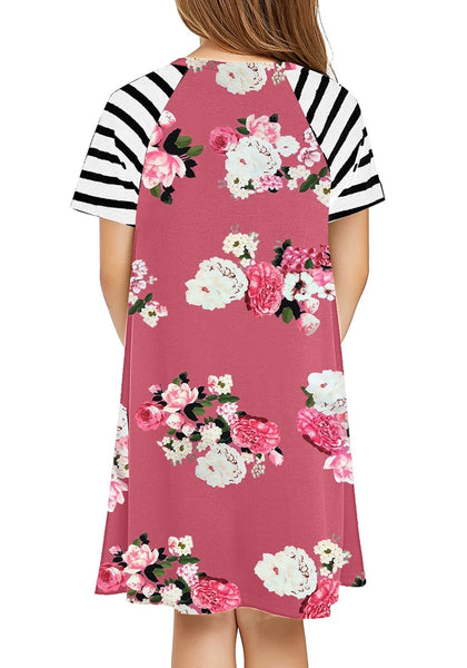 Back view of cute girl in mauve pink raglan sleeves floral tunic girls' shirt dress