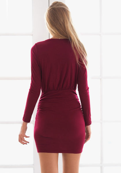 Back view of falu red ruched wrap-style dress