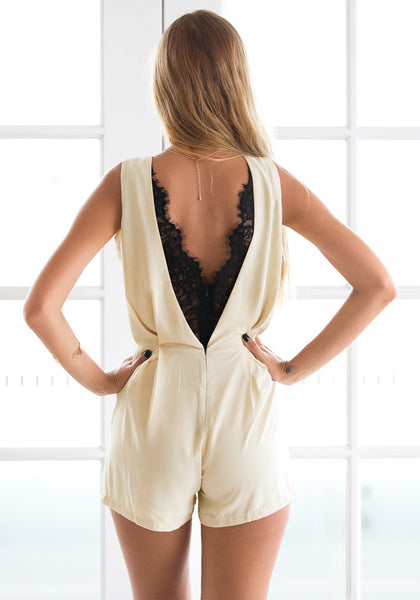 Back view of girl in apricot V back lace romper