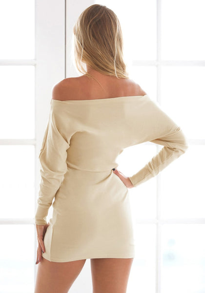 Back view of girl in beige one-shoulder dress