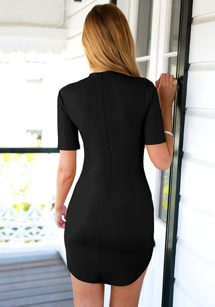 Back view of girl in black curved-hem bodycon dress