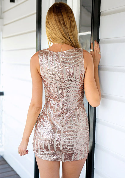 Back view of girl in champagne sequin party dress