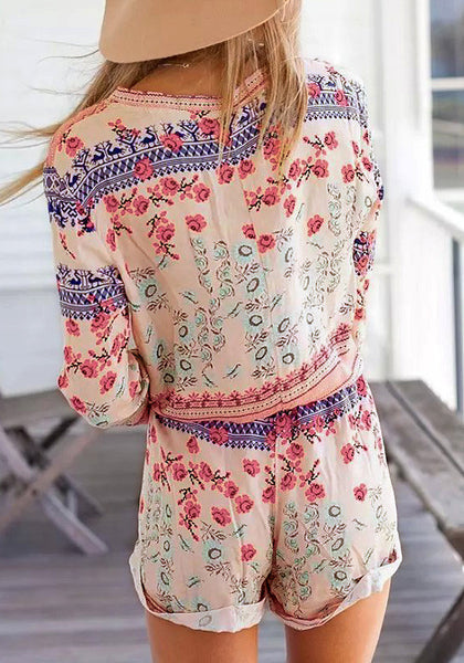 Back view of girl in floral lace up romper